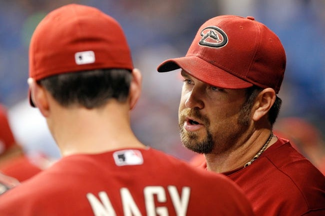 Jul 31, 2013; St. Petersburg, FL, USA; Arizona Diamondbacks relief pitcher Heath Bell (21) talks with pitching coach Charles Nagy (50) in the dugout against the Tampa Bay Rays at Tropicana Field. Arizona Diamondbacks defeated the Tampa Bay Rays 7-0. Mandatory Credit: Kim Klement-USA TODAY Sports