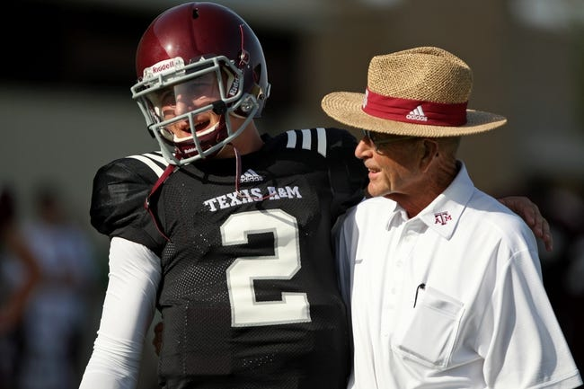 Aug 7, 2013; College Station, TX, USA; Texas A&M Aggies quarterback Johnny Manziel (2) talks with Billy Pickard during practice at Coolidge Field. Mandatory Credit: Troy Taormina-USA TODAY Sports