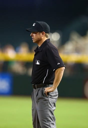 Jul. 9, 2013; Phoenix, AZ, USA: MLB umpire Hal Gibson III during the game between the Arizona Diamondbacks against the Los Angeles Dodgers at Chase Field. Mandatory Credit: Mark J. Rebilas-USA TODAY Sports