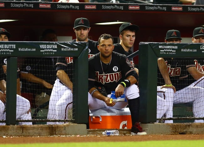 Jul. 9, 2013; Phoenix, AZ, USA: Arizona Diamondbacks outfielder A.J. Pollock (left), third baseman Martin Prado (center) and pitcher Patrick Corbin sit in the dugout against the Los Angeles Dodgers at Chase Field. Mandatory Credit: Mark J. Rebilas-USA TODAY Sports