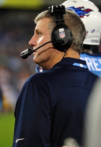 Aug 8, 2013; Nashville, TN, USA; Tennessee Titans head coach Mike Munchak watches his team play against the Washington Redskins during the second half at LP Field. The Redskins beat the Titans 22-21. Mandatory Credit: Don McPeak-USA TODAY Sports