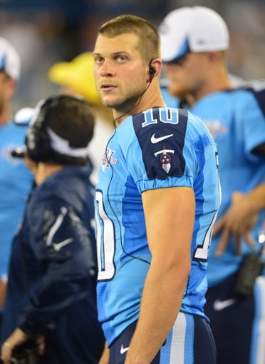 Aug 8, 2013; Nashville, TN, USA; Tennessee Titans quarterback Jake Locker (10) rest on the sidelines in a game against the Washington Redskins during the second half at LP Field. The Redskins beat the Titans 22-21. Mandatory Credit: Don McPeak-USA TODAY Sports