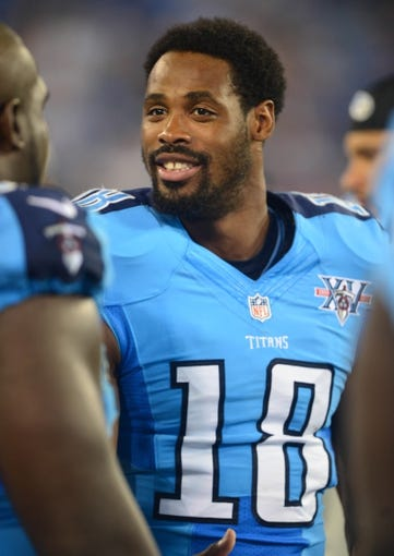 Aug 8, 2013; Nashville, TN, USA; Tennessee Titans wide receiver Kenny Britt (18) on the sidelines in a game against the Washington Redskins during the second half at LP Field. The Redskins beat the Titans 22-21. Mandatory Credit: Don McPeak-USA TODAY Sports