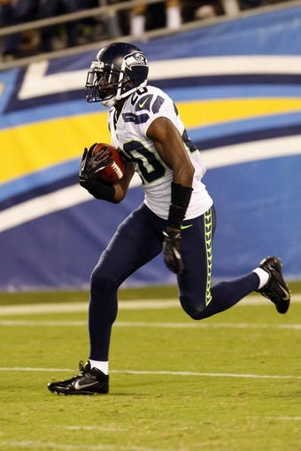 Aug 8, 2013; San Diego, CA, USA; Seattle Seahawks corner Jeremy  Lane  (20) carries the kick off return against the San Diego Chargers  at Qualcomm Stadium. Mandatory Credit: Jody Gomez-USA TODAY Sports