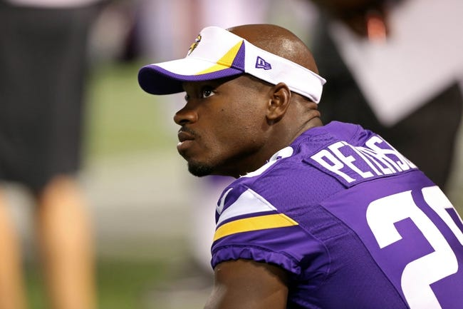 Aug 9, 2013; Minneapolis, MN, USA; Minnesota Vikings running back Adrian Peterson (28) looks on from the sidelines during the third quarter against the Houston Texans at the Metrodome. The Texans won 27-13. Mandatory Credit: Jesse Johnson-USA TODAY Sports