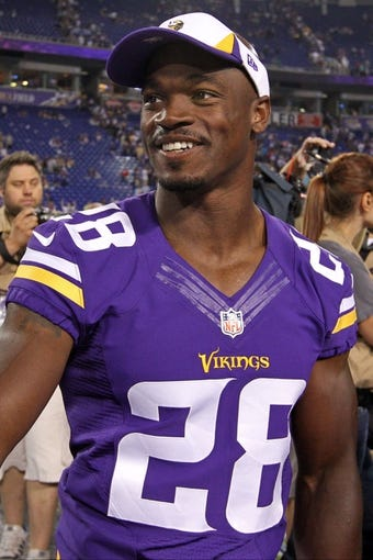 Aug 9, 2013; Minneapolis, MN, USA; Minnesota Vikings running back Adrian Peterson (28) looks on following the game against the Houston Texans at the Metrodome. The Texans defeated the Vikings 27-13. Mandatory Credit: Brace Hemmelgarn-USA TODAY Sports