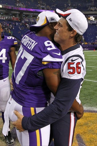 Aug 9, 2013; Minneapolis, MN, USA; Houston Texans inside linebacker Brian Cushing (56) talks with Minnesota Vikings defensive end Everson Griffen (97) following the game at the Metrodome. The Texans defeated the Vikings 27-13. Mandatory Credit: Brace Hemmelgarn-USA TODAY Sports
