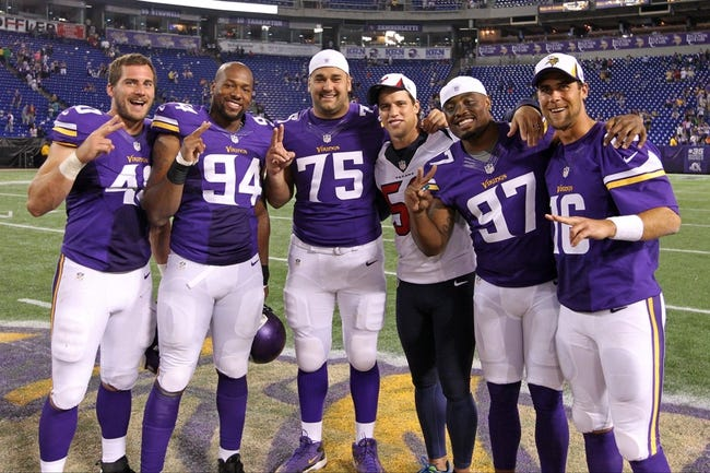 Aug 9, 2013; Minneapolis, MN, USA; Houston Texans inside linebacker Brian Cushing (56) poses for a photo with Minnesota Vikings tight end Rhett Ellison (40), defensive end Lawrence Jackson (94), tackle Matt Kalil (75), defensive end Everson Griffen (97) and quarterback Matt Cassel (16) following the game at the Metrodome. The Texans defeated the Vikings 27-13. Mandatory Credit: Brace Hemmelgarn-USA TODAY Sports