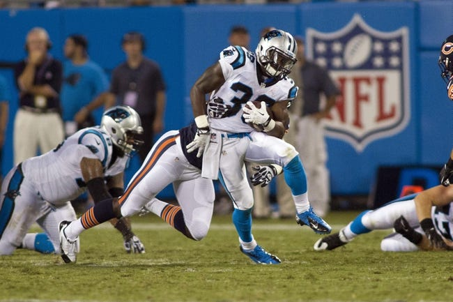 Aug 9, 2013; Charlotte, NC, USA; Carolina Panthers running back Armond Smith (36) runs the ball against the Chicago Bears during the second half. The Panthers defeated the Bears 24-17. Mandatory Credit: Jeremy Brevard-USA TODAY Sports