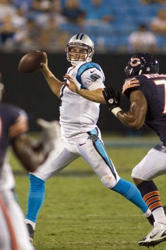 Aug 9, 2013; Charlotte, NC, USA; Carolina Panthers quarterback Jimmy Clausen (7) throws the ball during the second half against the against the Chicago Bears. The Panthers defeated the Bears 24-17. Mandatory Credit: Jeremy Brevard-USA TODAY Sports