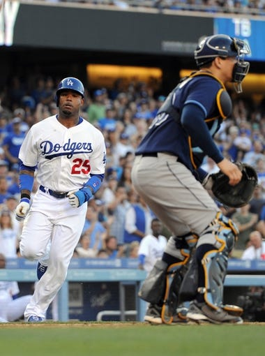 Aug 11, 2013; Los Angeles, CA, USA;   Los Angeles Dodgers left fielder Carl Crawford (25) comes in to score a run past Tampa Bay Rays catcher Jose Lobaton (59) in the third inning of the game at Dodger Stadium. Mandatory Credit: Jayne Kamin-Oncea-USA TODAY Sports