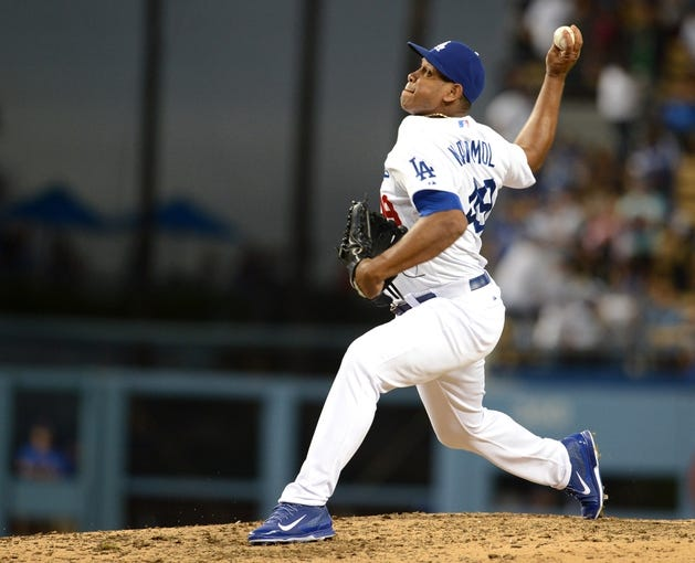 Aug 11, 2013; Los Angeles, CA, USA;   Los Angeles Dodgers relief pitcher Carlos Marmol (49) throws in the 9th inning against the Tampa Bay Rays at Dodger Stadium. Dodgers won 8-2. Mandatory Credit: Jayne Kamin-Oncea-USA TODAY Sports