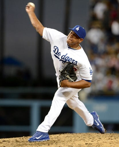 Aug 11, 2013; Los Angeles, CA, USA;   Los Angeles Dodgers relief pitcher Carlos Marmol (49) gets the save in the ninth inning of the game against the Tampa Bay Rays at Dodger Stadium. Dodgers won 8-2. Mandatory Credit: Jayne Kamin-Oncea-USA TODAY Sports