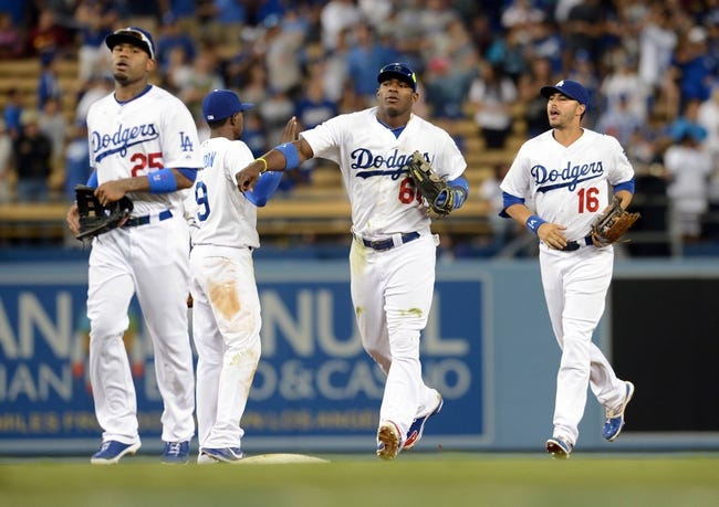 Aug 11, 2013; Los Angeles, CA, USA;   Los Angeles Dodgers outfielders Carl Crawford (25) and Yasiel Puig (66) and Andre Ethier (16) come off the field at the end of the game against the Tampa Bay Rays at Dodger Stadium. Dodgers won 8-2. Mandatory Credit: Jayne Kamin-Oncea-USA TODAY Sports