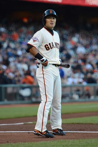 July 9, 2013; San Francisco, CA, USA; San Francisco Giants left fielder Kensuke Tanaka (37) reacts after fouling off a ball during the first inning against the New York Mets at AT&T Park. The Mets defeated the Giants 10-6. Mandatory Credit: Kyle Terada-USA TODAY Sports