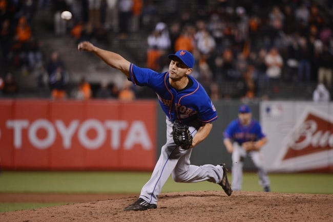 July 9, 2013; San Francisco, CA, USA; New York Mets relief pitcher Carlos Torres (52) delivers a pitch during the ninth inning against the San Francisco Giants at AT&T Park. The Mets defeated the Giants 10-6. Mandatory Credit: Kyle Terada-USA TODAY Sports