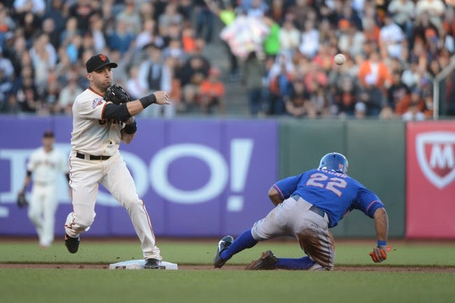 July 9, 2013; San Francisco, CA, USA; San Francisco Giants second baseman Marco Scutaro (19, left) completes a double play as New York Mets center fielder Eric Young Jr. (22) slides into second base during the first inning at AT&T Park. The Mets defeated the Giants 10-6. Mandatory Credit: Kyle Terada-USA TODAY Sports