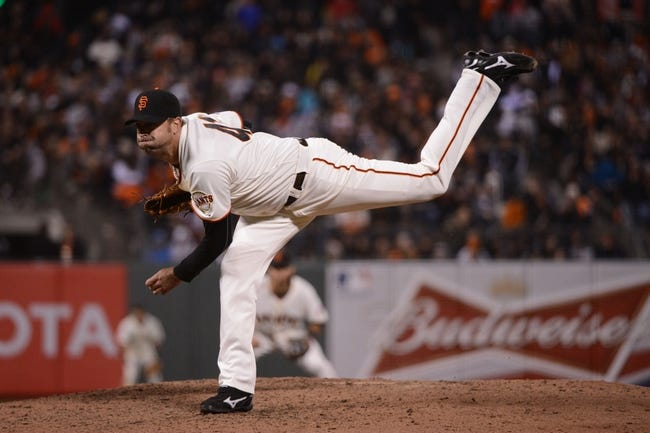 July 9, 2013; San Francisco, CA, USA; San Francisco Giants relief pitcher Jeremy Affeldt (41) delivers a pitch during the eighth inning against the New York Mets at AT&T Park. The Mets defeated the Giants 10-6. Mandatory Credit: Kyle Terada-USA TODAY Sports