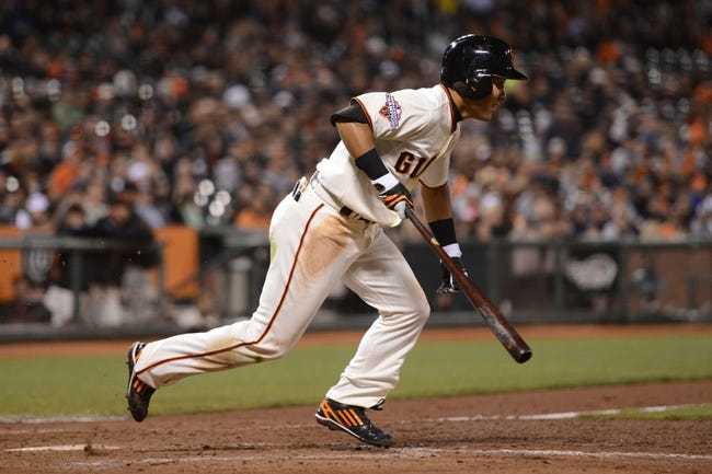 July 9, 2013; San Francisco, CA, USA; San Francisco Giants left fielder Kensuke Tanaka (37) runs to first base during the eighth inning against the New York Mets at AT&T Park. The Mets defeated the Giants 10-6. Mandatory Credit: Kyle Terada-USA TODAY Sports