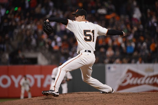 July 9, 2013; San Francisco, CA, USA; San Francisco Giants relief pitcher Jake Dunning (51) delivers a pitch during the eighth inning against the New York Mets at AT&T Park. The Mets defeated the Giants 10-6. Mandatory Credit: Kyle Terada-USA TODAY Sports