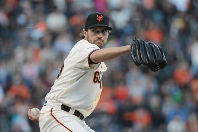 July 9, 2013; San Francisco, CA, USA; San Francisco Giants starting pitcher Barry Zito (75) delivers a pitch during the first inning against the New York Mets at AT&T Park. The Mets defeated the Giants 10-6. Mandatory Credit: Kyle Terada-USA TODAY Sports