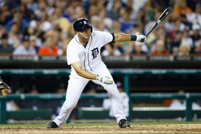 Jul 30, 2013; Detroit, MI, USA; Detroit Tigers shortstop Jhonny Peralta (27) hits a single in the eighth inning against the Washington Nationals at Comerica Park. Mandatory Credit: Rick Osentoski-USA TODAY Sports