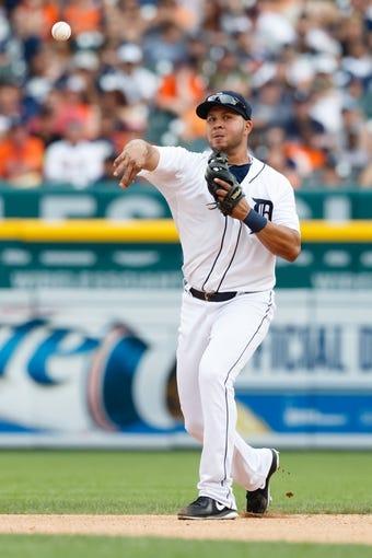Jul 31, 2013; Detroit, MI, USA; Detroit Tigers shortstop Jhonny Peralta (27) makes a throw against the Washington Nationals at Comerica Park. Mandatory Credit: Rick Osentoski-USA TODAY Sports