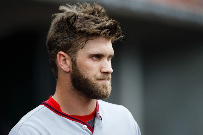 Jul 31, 2013; Detroit, MI, USA; Washington Nationals left fielder Bryce Harper (34) in the dugout against the Detroit Tigers at Comerica Park. Mandatory Credit: Rick Osentoski-USA TODAY Sports