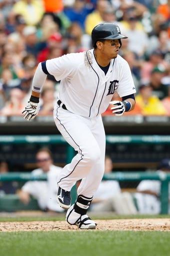 Jul 31, 2013; Detroit, MI, USA; Detroit Tigers designated hitter Victor Martinez (41) runs towards first against the Washington Nationals at Comerica Park. Mandatory Credit: Rick Osentoski-USA TODAY Sports