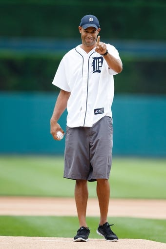 Jul 31, 2013; Detroit, MI, USA; Miami Heat small forward Shane Battier throws out the ceremonial first pitch before the game between the Detroit Tigers and the Washington Nationals at Comerica Park. Mandatory Credit: Rick Osentoski-USA TODAY Sports