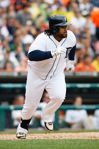 Jul 31, 2013; Detroit, MI, USA; Detroit Tigers first baseman Prince Fielder (28) runs towards first against the Washington Nationals at Comerica Park. Mandatory Credit: Rick Osentoski-USA TODAY Sports
