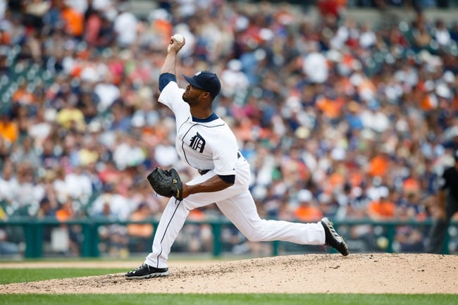 Jul 31, 2013; Detroit, MI, USA; Detroit Tigers relief pitcher Al Alburquerque (62) pitches in the eighth inning against the Washington Nationals at Comerica Park. Detroit won 11-1. Mandatory Credit: Rick Osentoski-USA TODAY Sports
