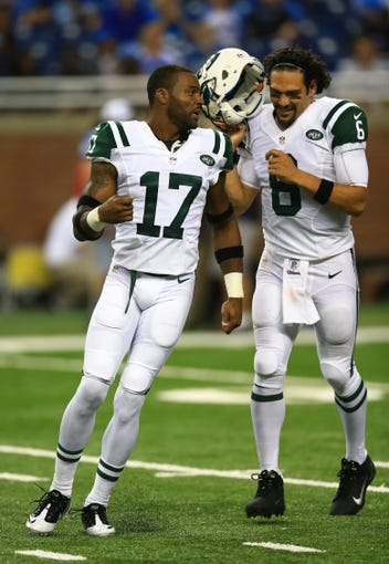 Aug 9, 2013; Detroit, MI, USA; New York Jets wide receiver Braylon Edwards (17) and Mark Sanchez (6) during a preseason game against the Detroit Lions at Ford Field. Mandatory Credit: Andrew Weber-USA TODAY Sports