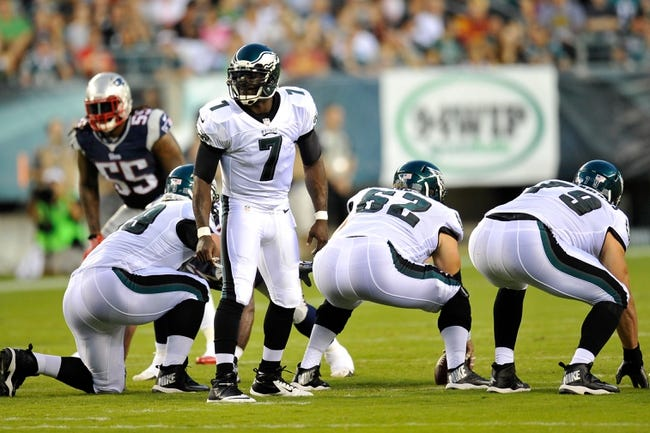 Aug 9, 2013; Philadelphia, PA, USA; Philadelphia Eagles quarterback Michael Vick (7) audibles against the New England Patriots during the first half of a preseason game at Lincoln Financial Field. The Patriots won 31-22. Mandatory Credit: Joe Camporeale-USA TODAY Sports