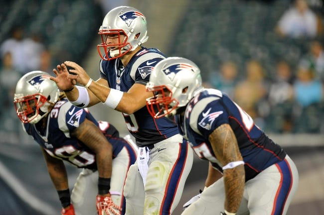 Aug 9, 2013; Philadelphia, PA, USA; New England Patriots quarterback Tim Tebow (5) calls a play at the line of scrimmage during the first half of a preseason game against the Philadelphia Eagles at Lincoln Financial Field. The Patriots won 31-22. Mandatory Credit: Joe Camporeale-USA TODAY Sports