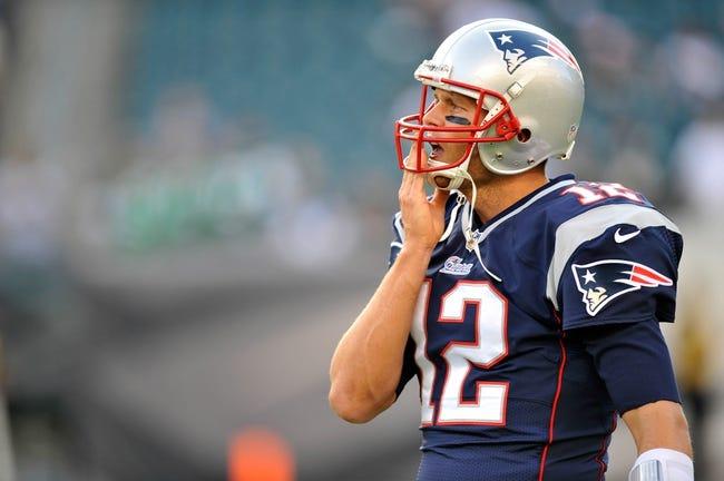 Aug 9, 2013; Philadelphia, PA, USA; New England Patriots quarterback Tom Brady (12) before the first half of a preseason game against the Philadelphia Eagles at Lincoln Financial Field. The Patriots won 31-22. Mandatory Credit: Joe Camporeale-USA TODAY Sports