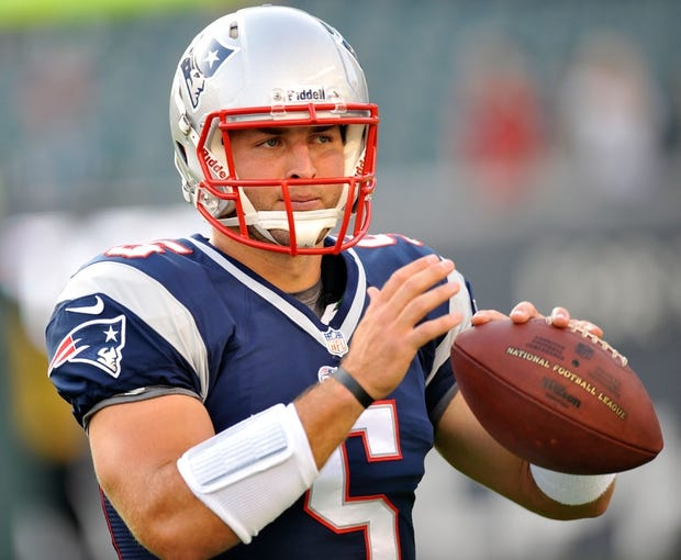 Aug 9, 2013; Philadelphia, PA, USA; New England Patriots quarterback Tim Tebow (5) warms up before the first half of a preseason game against the Philadelphia Eagles at Lincoln Financial Field. The Patriots won 31-22. Mandatory Credit: Joe Camporeale-USA TODAY Sports