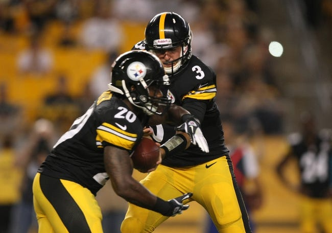 Aug 10, 2013; Pittsburgh, PA, USA; Pittsburgh Steelers quarterback Landry Jones (3) hands the ball off to running back Baron Batch (20) against the New York Giants during the second half at Heinz Field. The Giants won the game, 18-13. Mandatory Credit: Jason Bridge-USA TODAY Sports