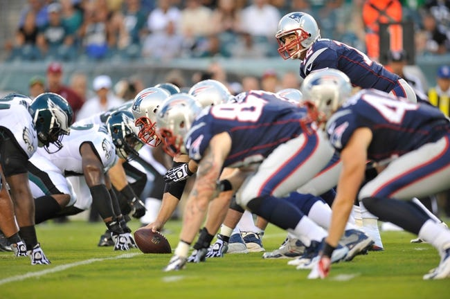 Aug 9, 2013; Philadelphia, PA, USA; New England Patriots quarterback Tom Brady (12) calls a play at the line of scrimmage against the Philadelphia Eagles during the first half of a preseason game at Lincoln Financial Field. The Patriots won 31-22. Mandatory Credit: Joe Camporeale-USA TODAY Sports