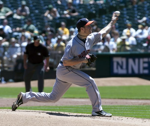 Aug 15, 2013; Oakland, CA, USA; Houston Astros starting pitcher Erik Bedard (45) pitches against the Oakland Athletics during the first inning at O.Co Coliseum. Mandatory Credit: Ed Szczepanski-USA TODAY Sports