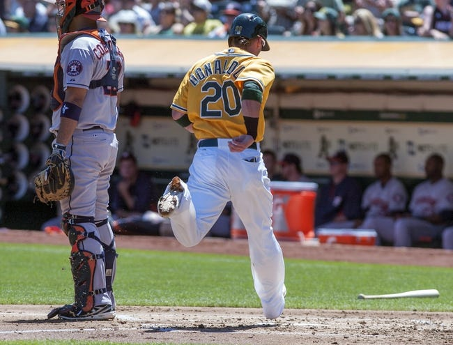 Aug 15, 2013; Oakland, CA, USA; Oakland Athletics third baseman Josh Donaldson (20) scores on a double by first baseman Nate Freiman (not pictured) during the first inning of the game against the Houston Astros at O.Co Coliseum. Mandatory Credit: Ed Szczepanski-USA TODAY Sports