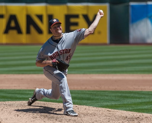 Aug 15, 2013; Oakland, CA, USA; Houston Astros starting pitcher Erik Bedard (45) pitches against the Oakland Athletics during the third inning at O.Co Coliseum. Mandatory Credit: Ed Szczepanski-USA TODAY Sports