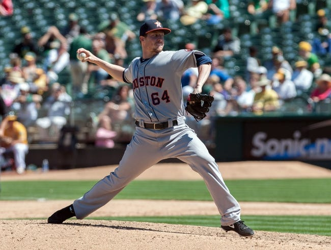 Aug 15, 2013; Oakland, CA, USA; Houston Astros starting pitcher Lucas Harrell (64) pitches against the Oakland Athletics during the sixth inning at O.Co Coliseum. The Oakland Athletics defeated the Houston Astros 5-0. Mandatory Credit: Ed Szczepanski-USA TODAY Sports
