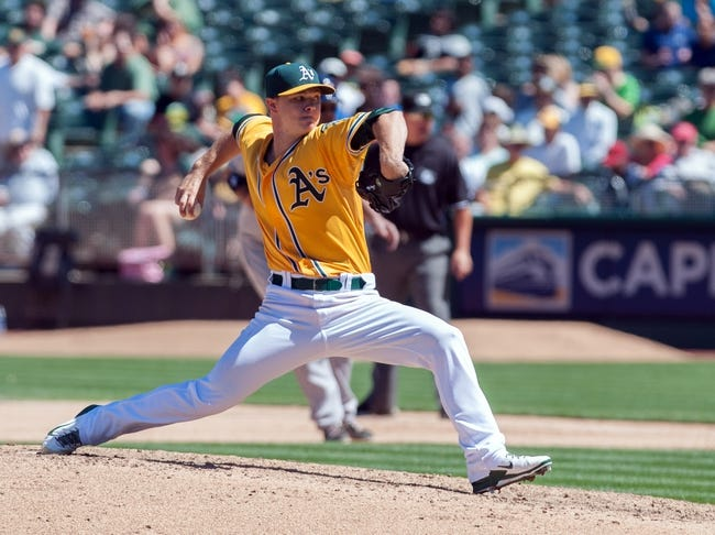 Aug 15, 2013; Oakland, CA, USA; Oakland Athletics starting pitcher Sonny Gray (54) pitches against the Houston Astros during the seventh inning at O.Co Coliseum. The Oakland Athletics defeated the Houston Astros 5-0. Mandatory Credit: Ed Szczepanski-USA TODAY Sports
