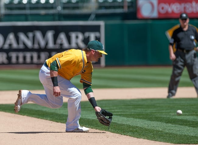 Aug 15, 2013; Oakland, CA, USA; Oakland Athletics third baseman Josh Donaldson (20) fields a ground ball during the eighth inning of the game against the Houston Astros at O.Co Coliseum. The Oakland Athletics defeated the Houston Astros 5-0. Mandatory Credit: Ed Szczepanski-USA TODAY Sports