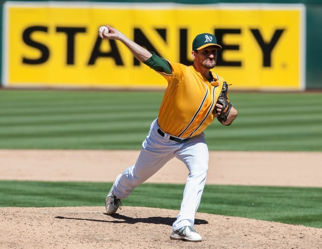 Aug 15, 2013; Oakland, CA, USA; Oakland Athletics relief pitcher Dan Otero (61) pitches in relief against the Houston Astros during the ninth inning at O.Co Coliseum. The Oakland Athletics defeated the Houston Astros 5-0. Mandatory Credit: Ed Szczepanski-USA TODAY Sports