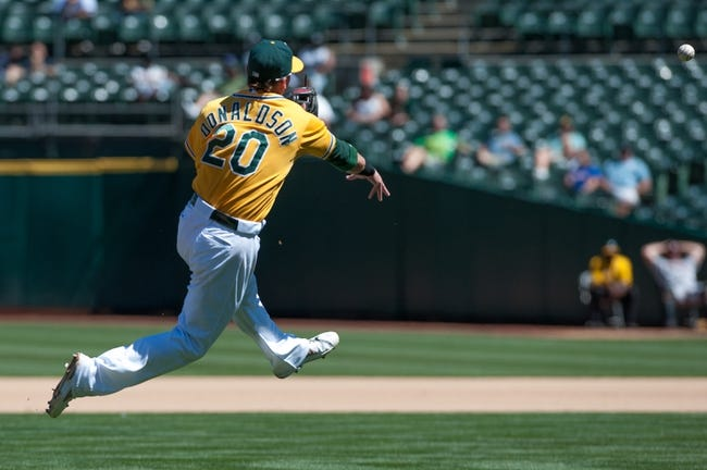 Aug 15, 2013; Oakland, CA, USA; Oakland Athletics third baseman Josh Donaldson (20) throws the ball to first during the eighth inning of the game against the Houston Astros at O.Co Coliseum. The Oakland Athletics defeated the Houston Astros 5-0. Mandatory Credit: Ed Szczepanski-USA TODAY Sports