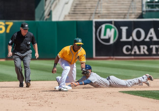 Aug 15, 2013; Oakland, CA, USA; Oakland Athletics second baseman Alberto Callaspo (18) attempts to tag out Houston Astros shortstop Jonathan Villar (6) during the eighth inning at O.Co Coliseum. The Oakland Athletics defeated the Houston Astros 5-0. Mandatory Credit: Ed Szczepanski-USA TODAY Sports