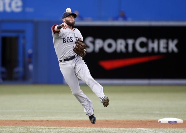 Aug 15, 2013; Toronto, Ontario, CAN; Boston Red Sox second baseman Dustin Pedroia (15) throws out Toronto Blue Jays shortstop Jose Reyes (not pictured) in the first inning at the Rogers Centre. Mandatory Credit: John E. Sokolowski-USA TODAY Sports