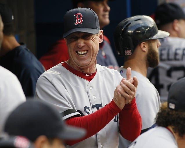 Aug 15, 2013; Toronto, Ontario, CAN; Boston Red Sox third base coach Brian Butterfield smiles in the dugout prior to a game against the Toronto Blue Jays at the Rogers Centre. Mandatory Credit: John E. Sokolowski-USA TODAY Sports